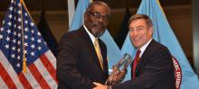 Dr. Richard Downie, Director of CHDS, presents the 2012 William J. Perry Award to Mr. Grantley Sylvester Watson, Regional Security Coordinator of the Regional Security System
